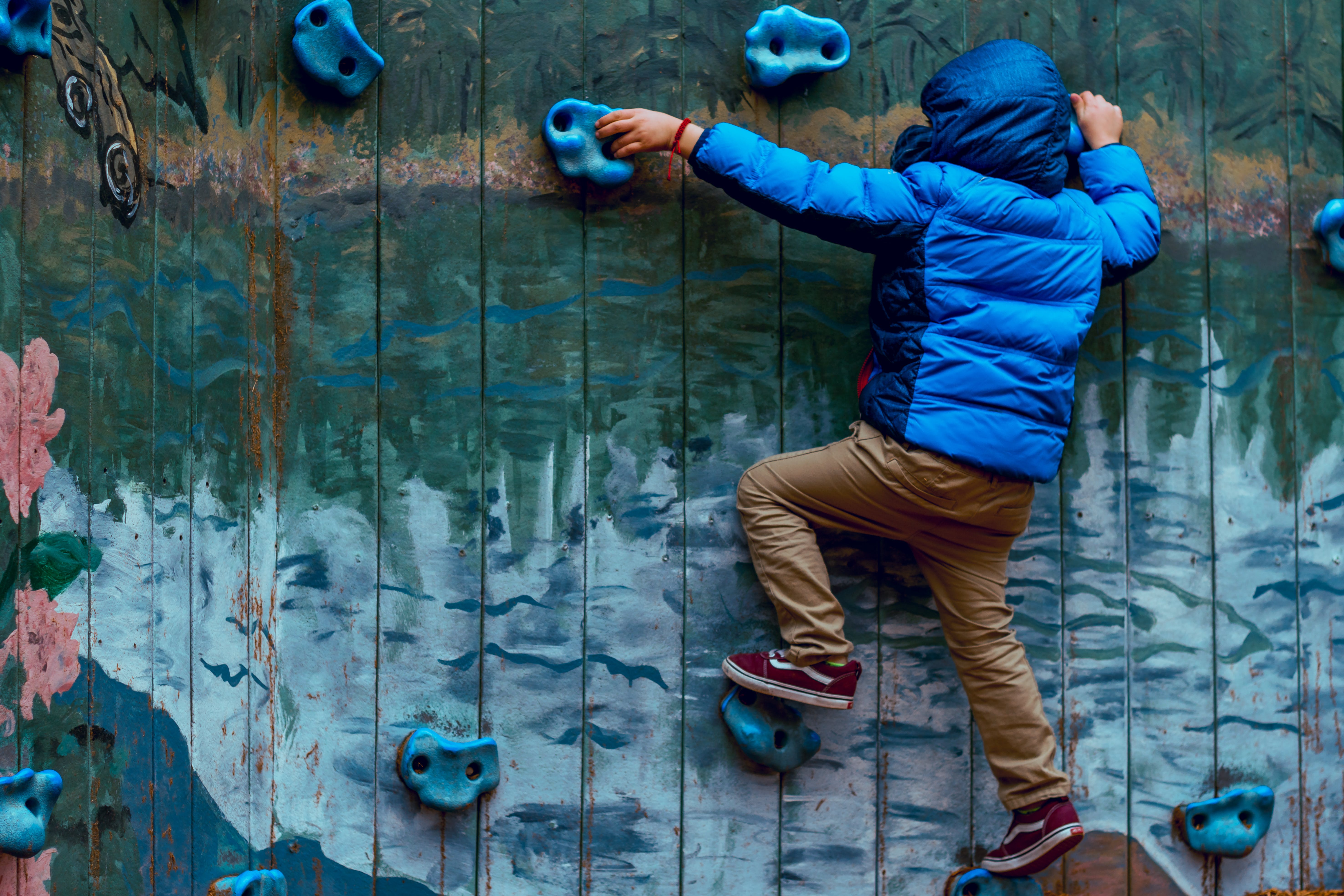 Photo of Boy Wall Climbing