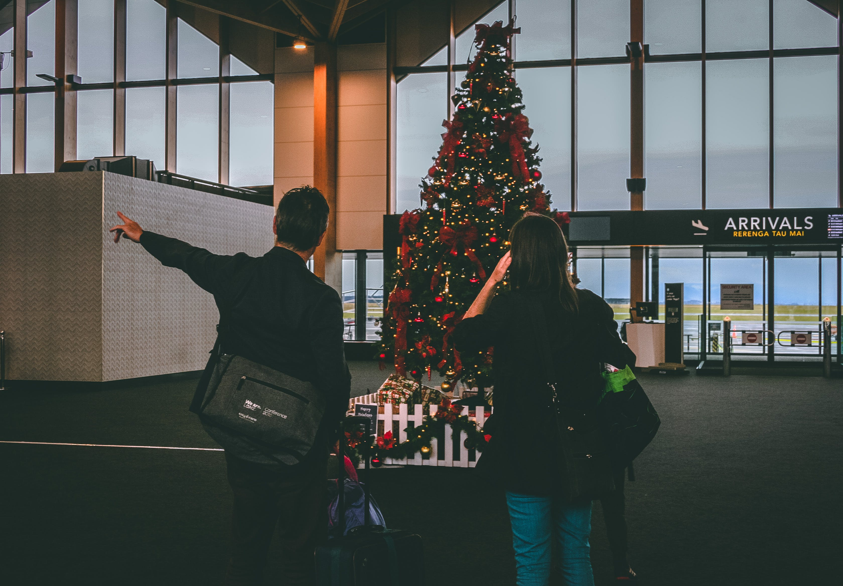 Man and Woman Staring at Christmas Tree