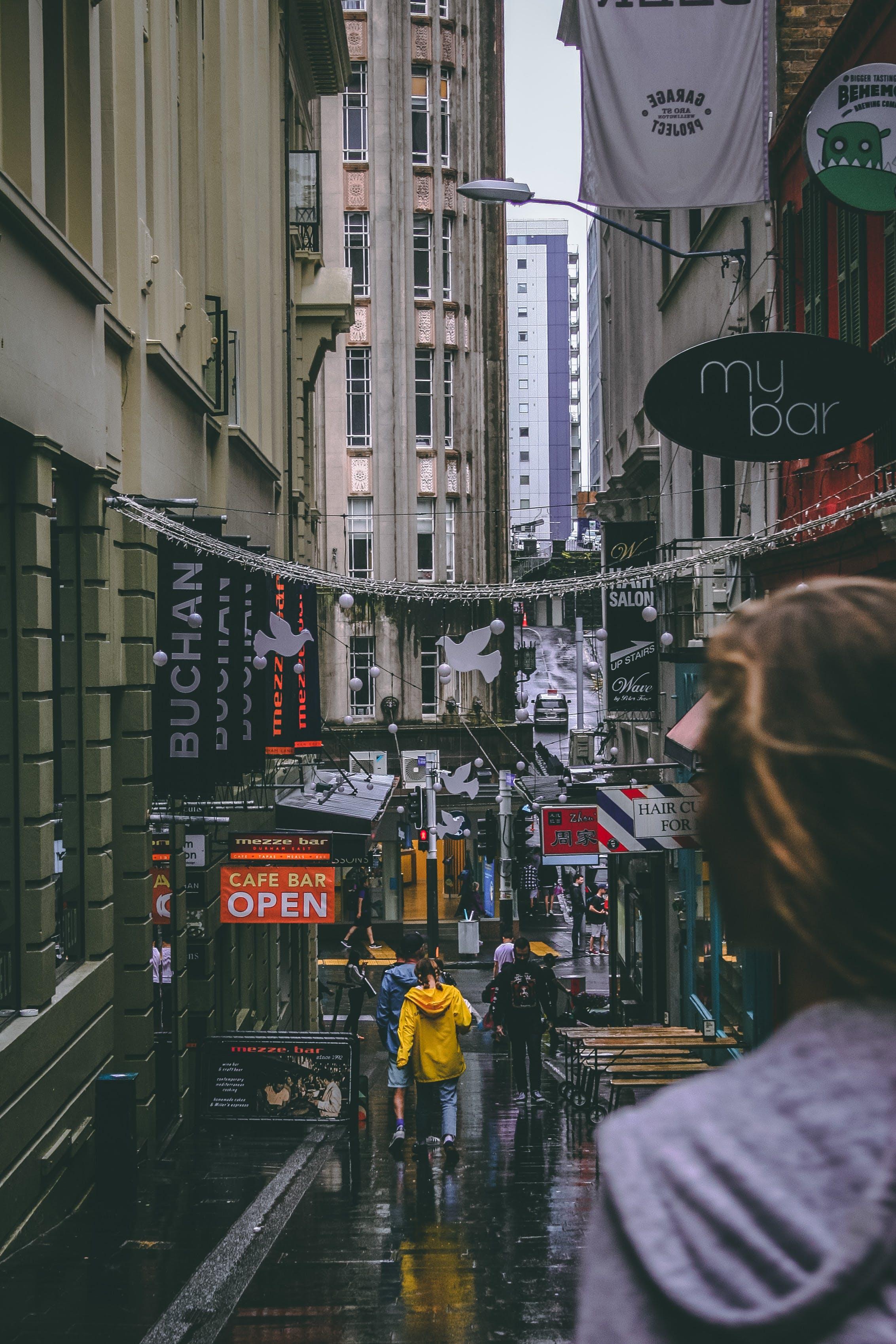 People Walking Between Buildings