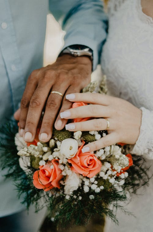 Man and Woman's Hands on Top of Ball Bouquet