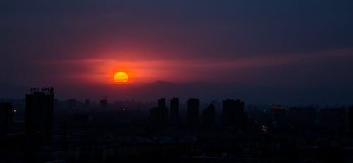 Безкоштовне стокове фото на тему «Захід сонця, місто, пекін, сонце»