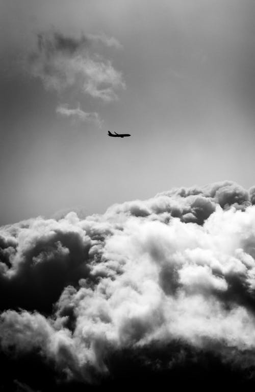 Grayscale Photography of Airplane In Sky