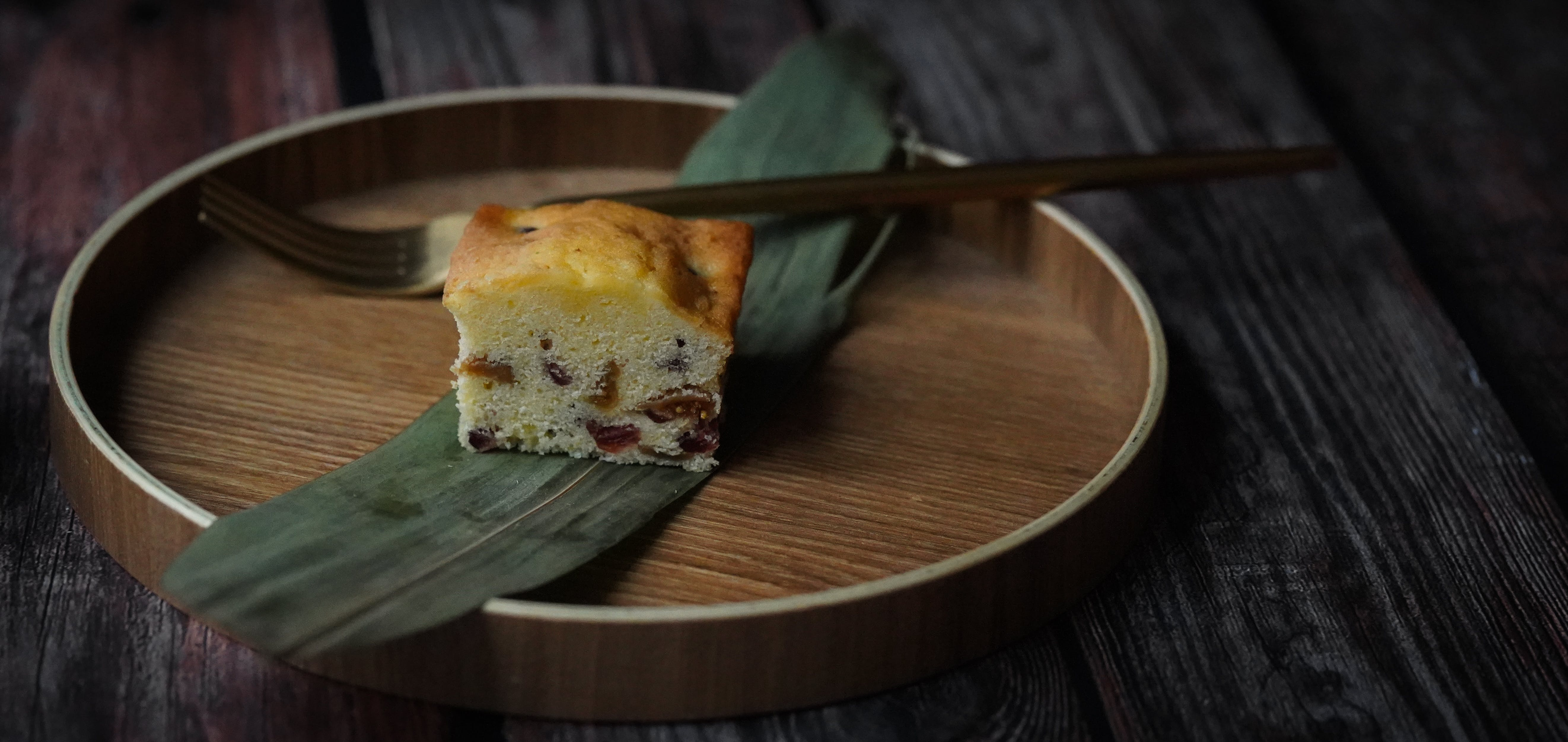 Sliced Baked Cake on Round Brown Plate