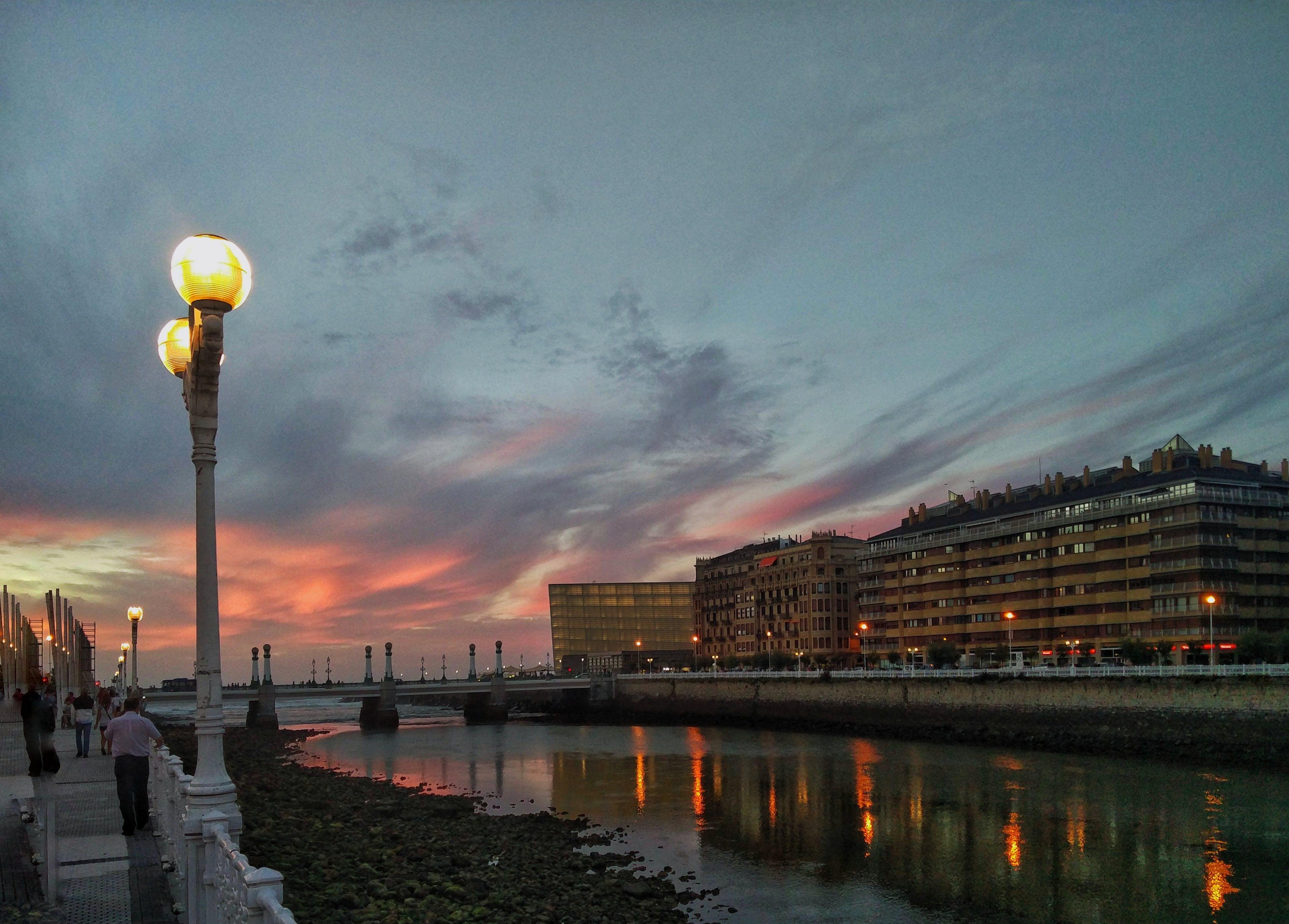Free stock photo of city scape, clowds, dusk, lights