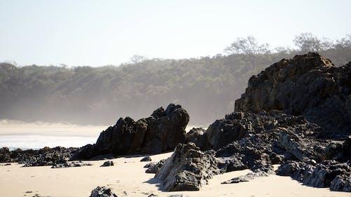 Photos gratuites de cailloux, côte rocheuse, plage, sable