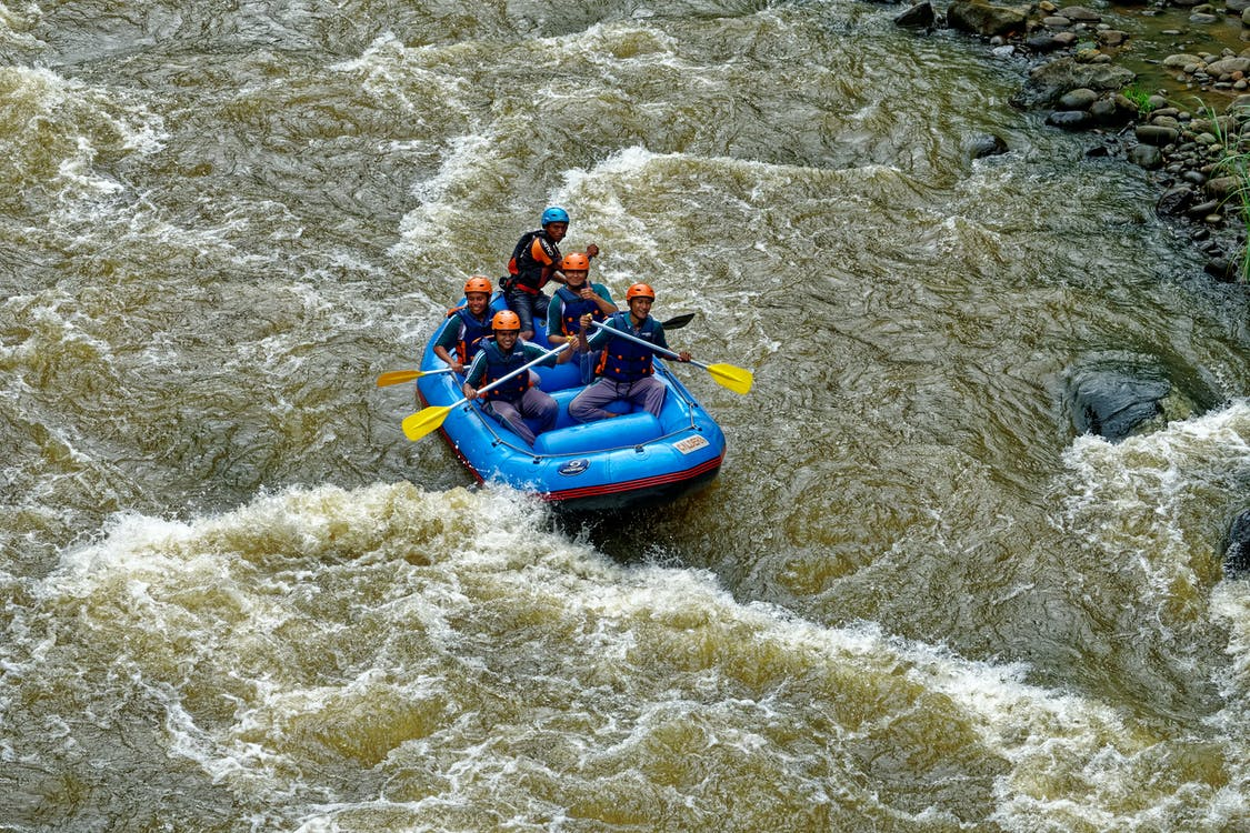 People Riding on Inflatable Boat