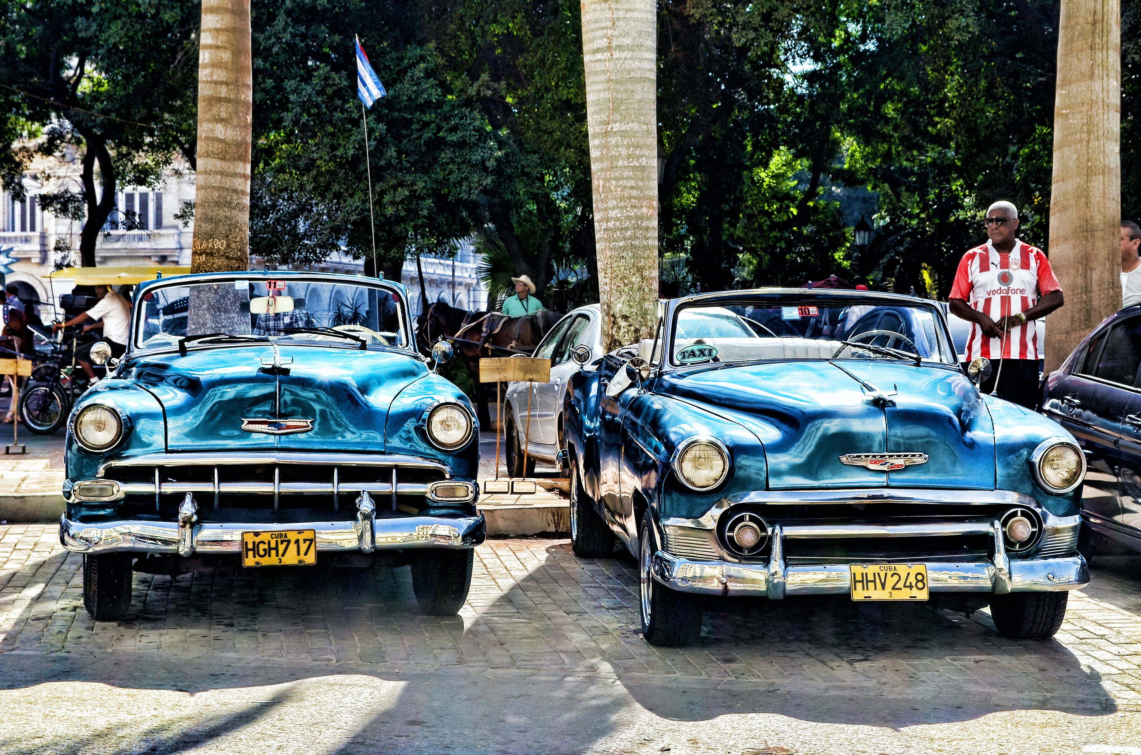 Blue Convertible Vintage Car Parked during Daytime