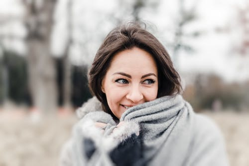 Selective Focus Photography of Woman Smiling