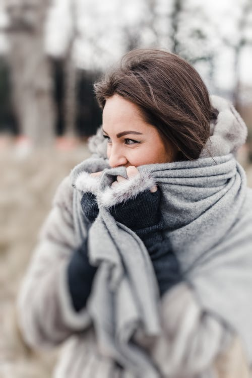 Selective Focus Photography of Woman Wearing Gray Scarf