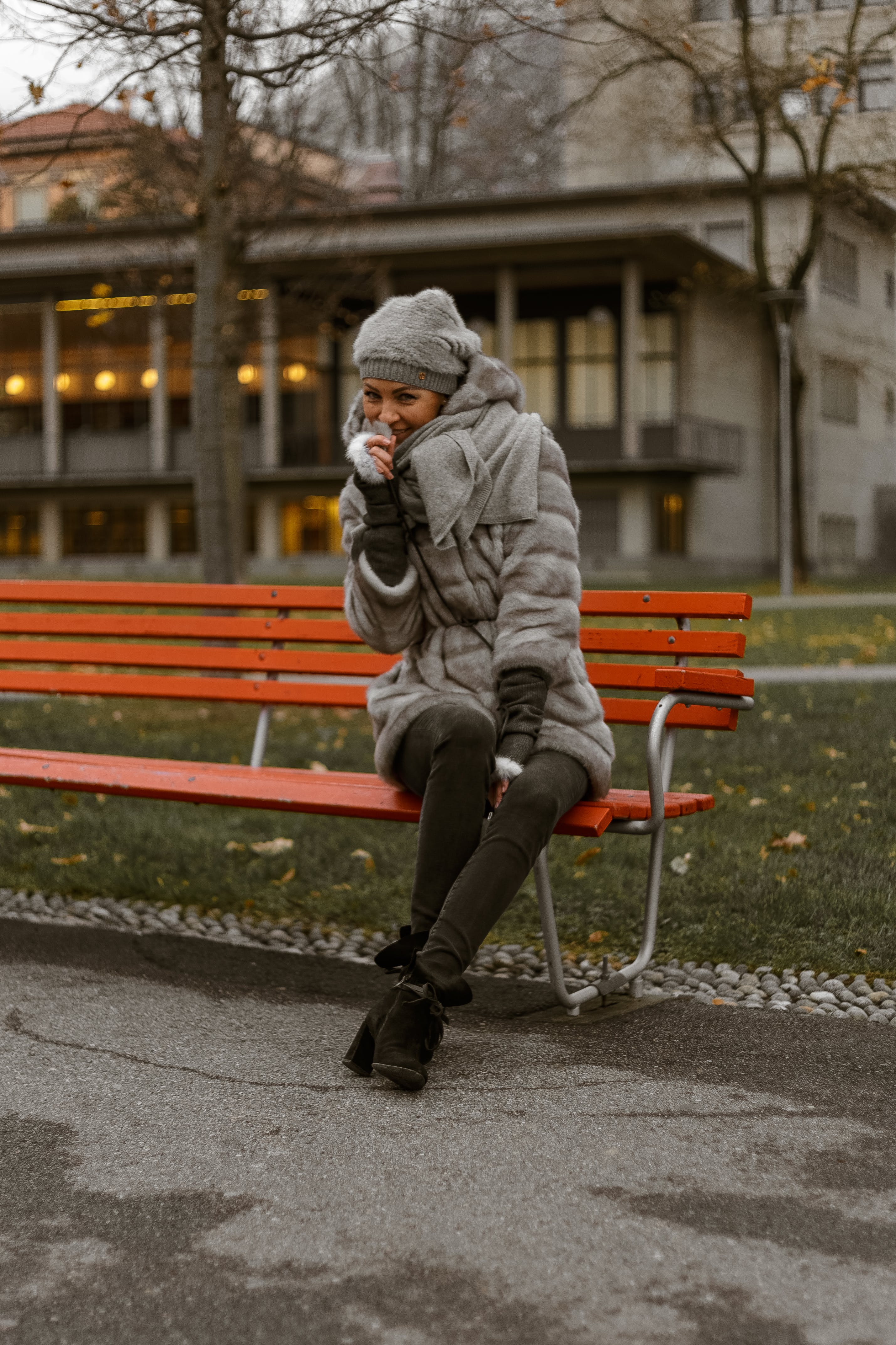 Smiling Photo of Woman Sitting on Park Bench