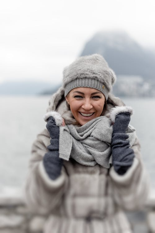 Photo of Smiling Woman in Winter Clothing
