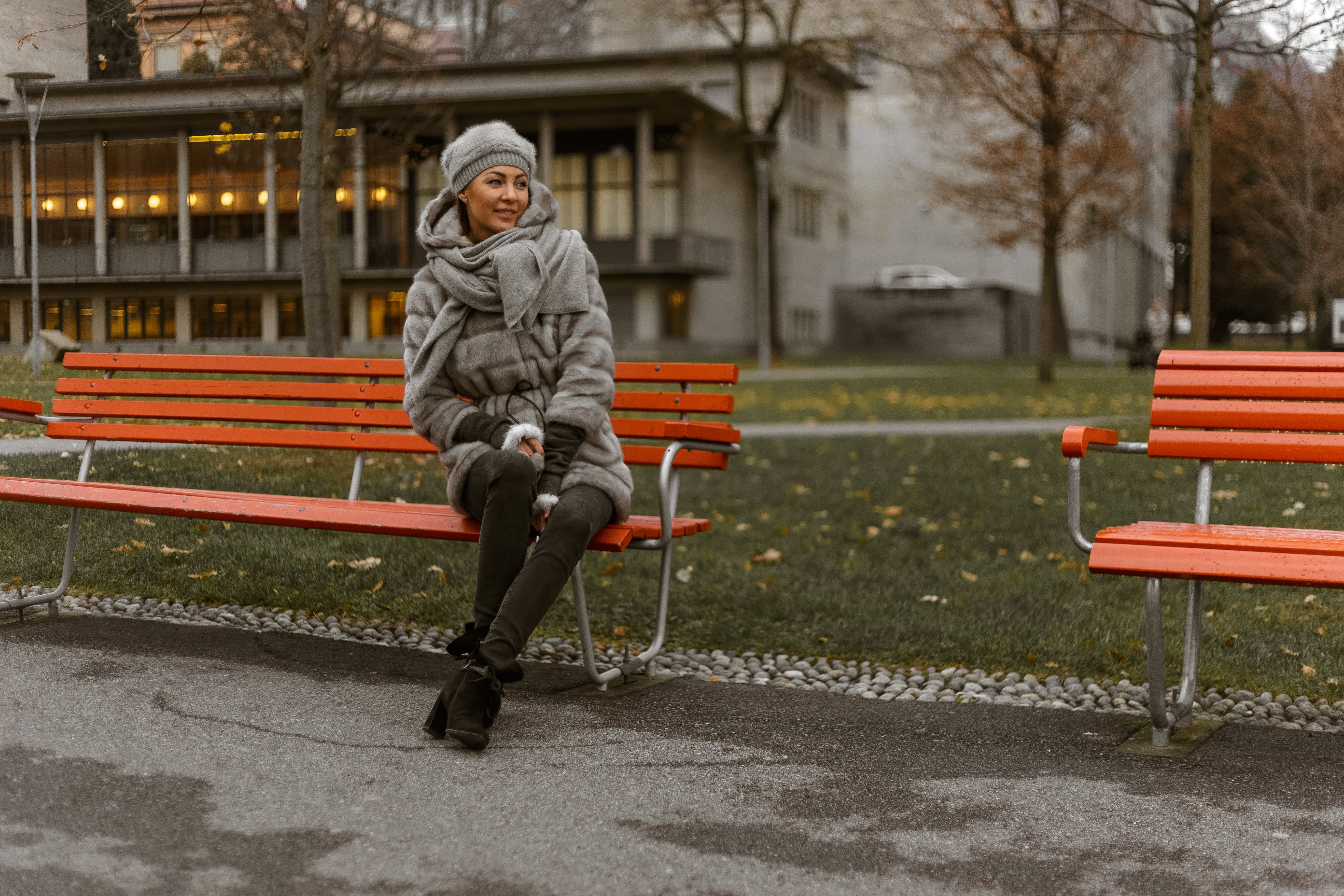 Photo of Woman Sitting on Park Bench