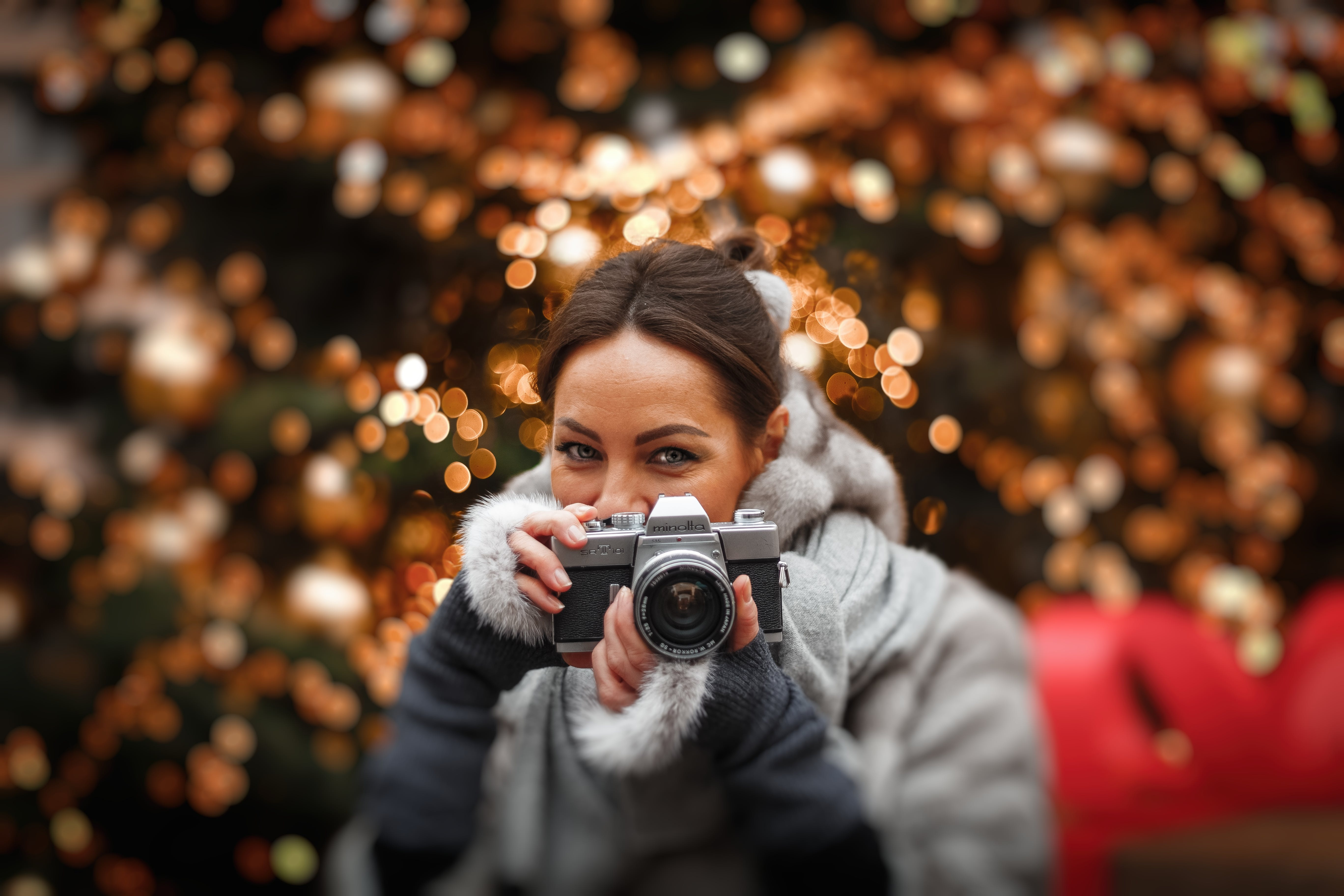 Woman Holding Camera In Selective Focus Photography