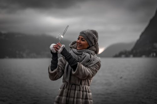 Photo of Woman Holding Sparklers