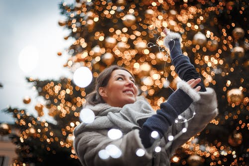 Photo of Woman Holding String Lights