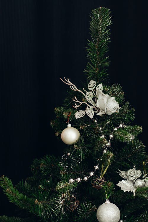 Green Christmas Tree With White Baubles and Flower Ornaments