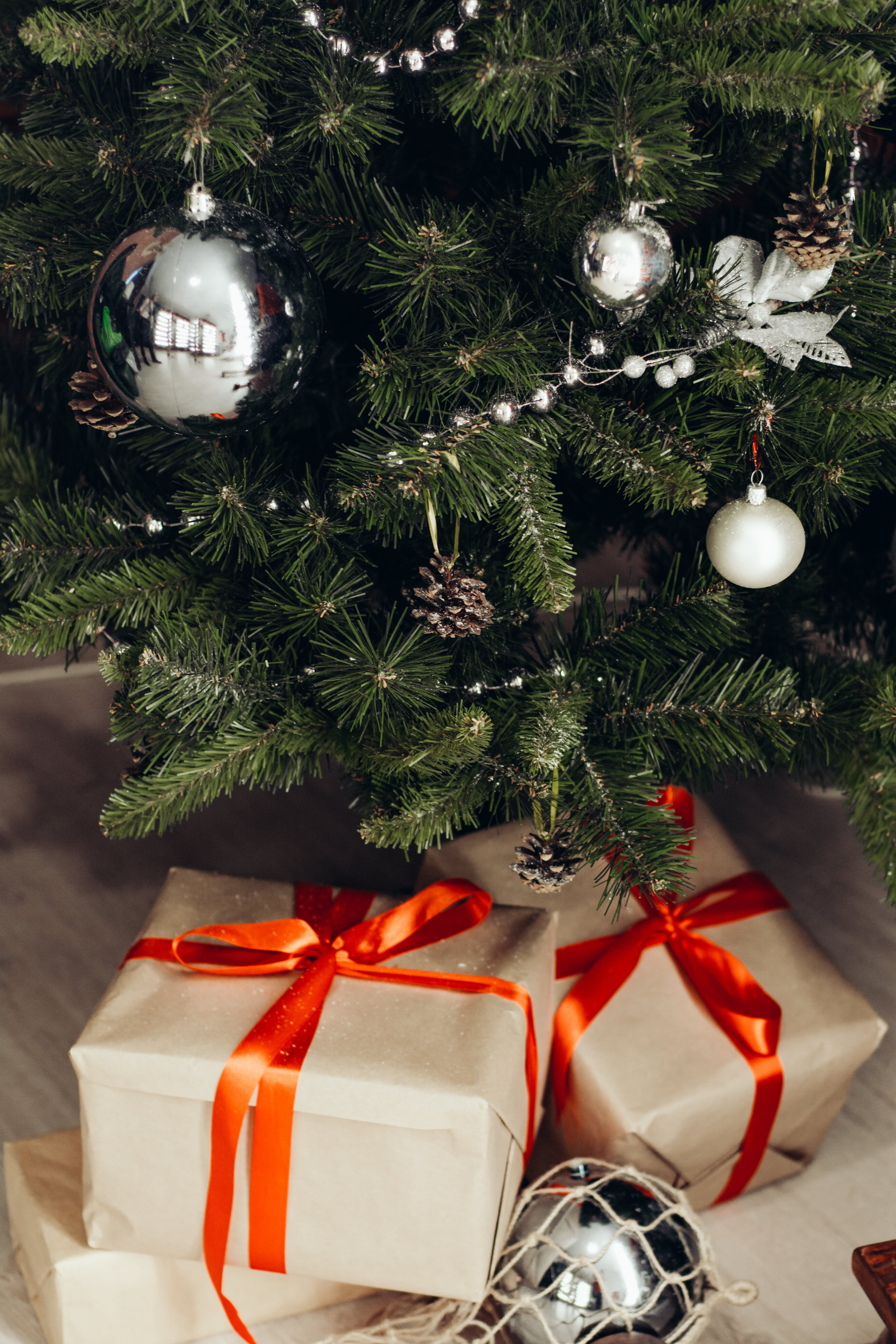 Photo of Gifts Under Christmas Tree
