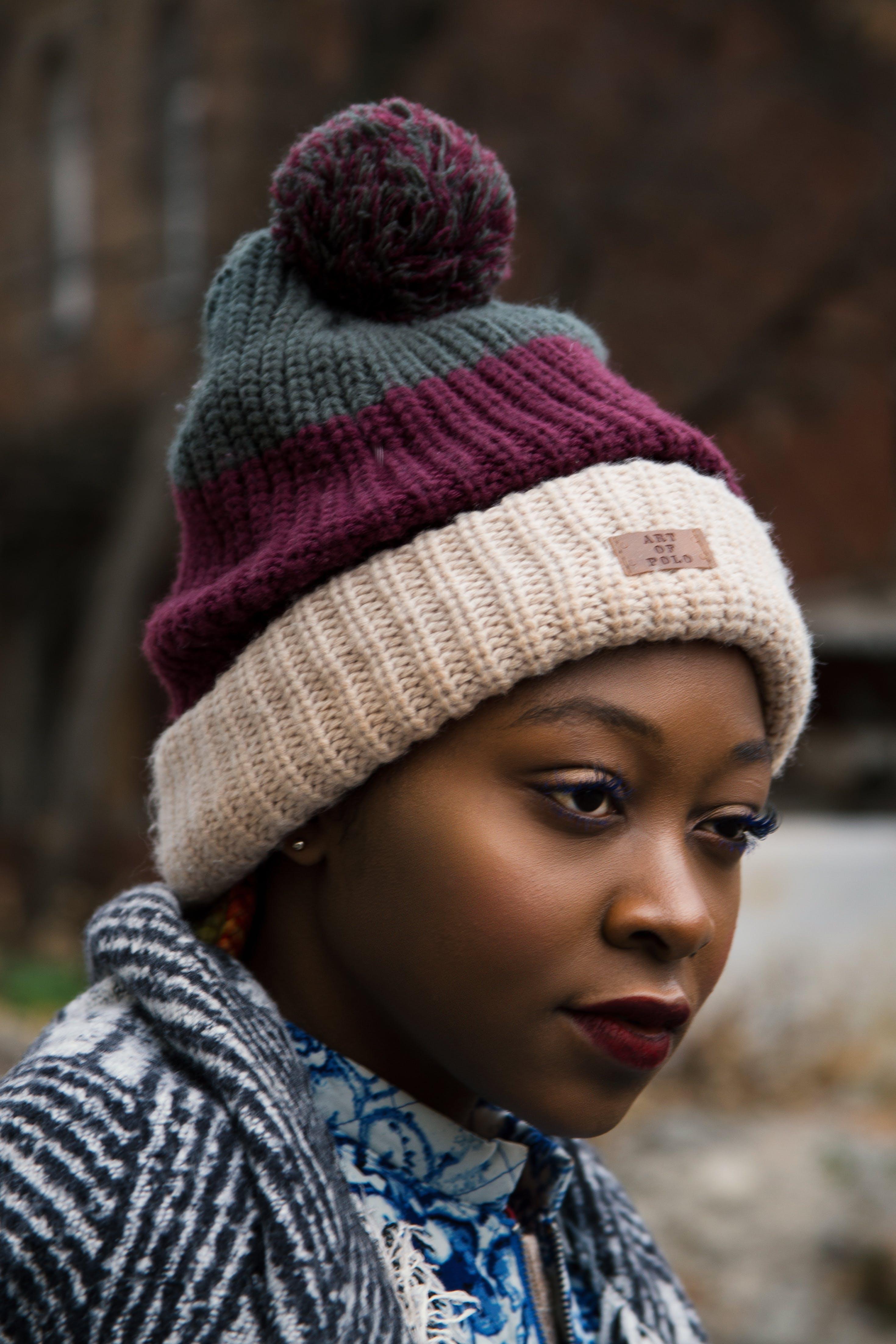 Woman Wearing Striped Bobble Hat