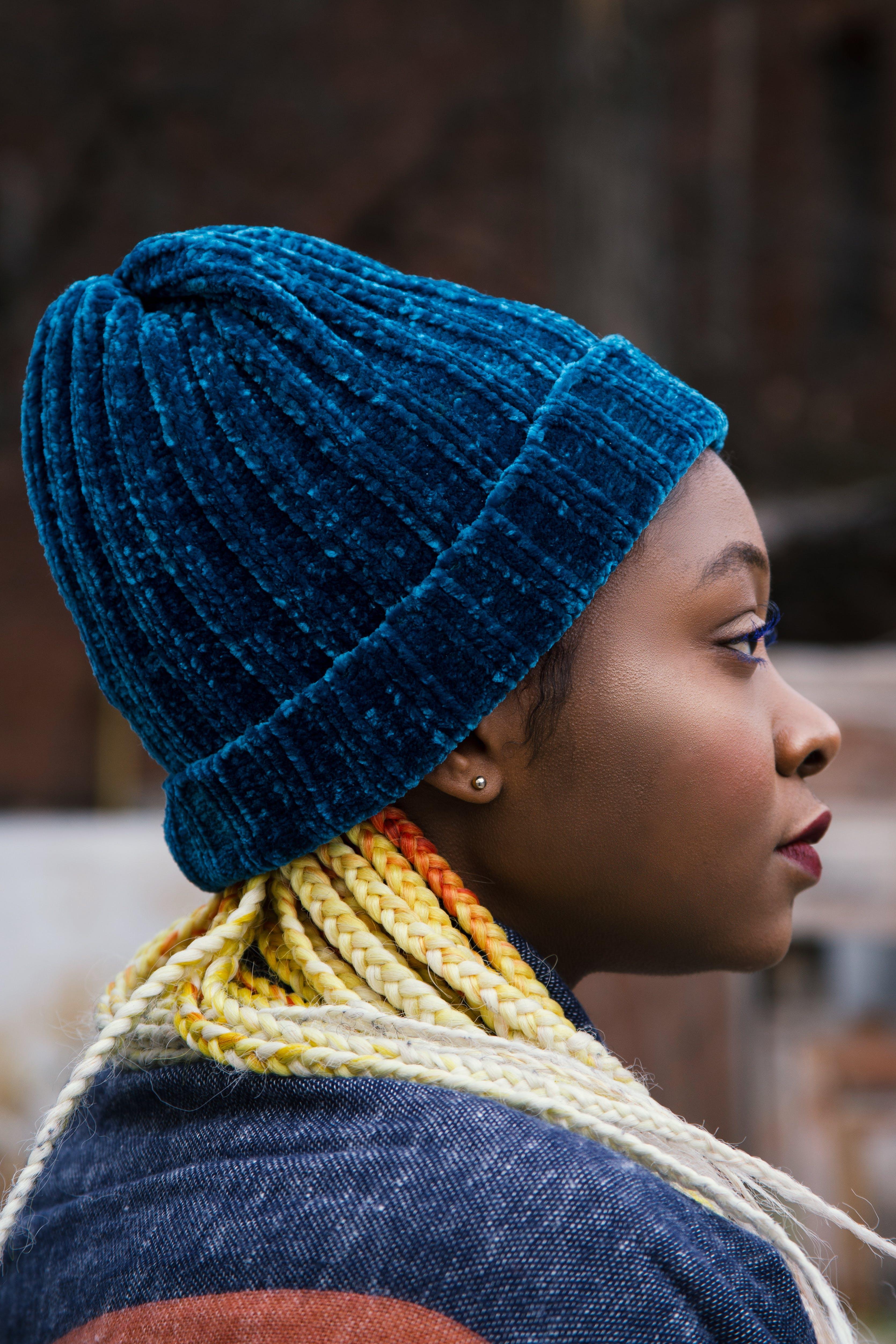 Woman Wearing Teal Knit Cap