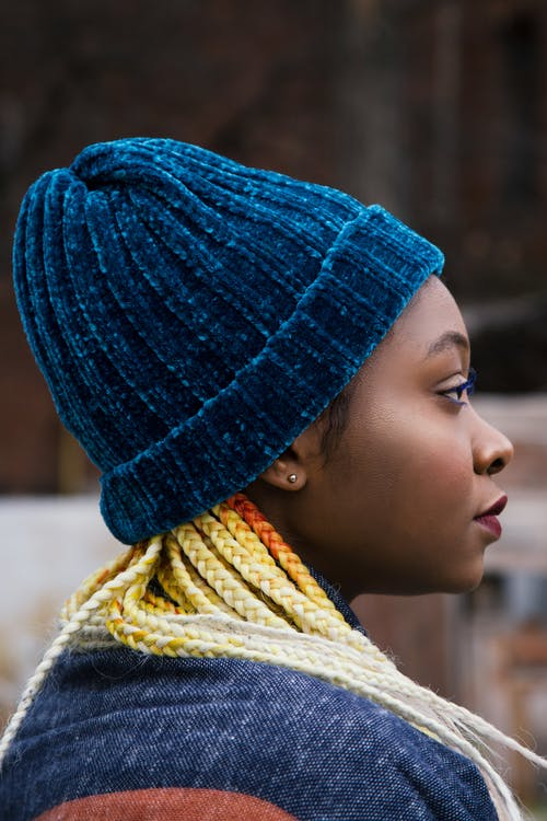 Woman Wearing Teal Knit Cap