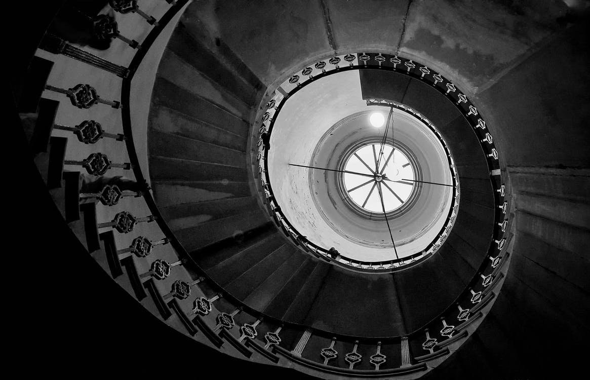 Low-Angle Photo of Spiral Stairs