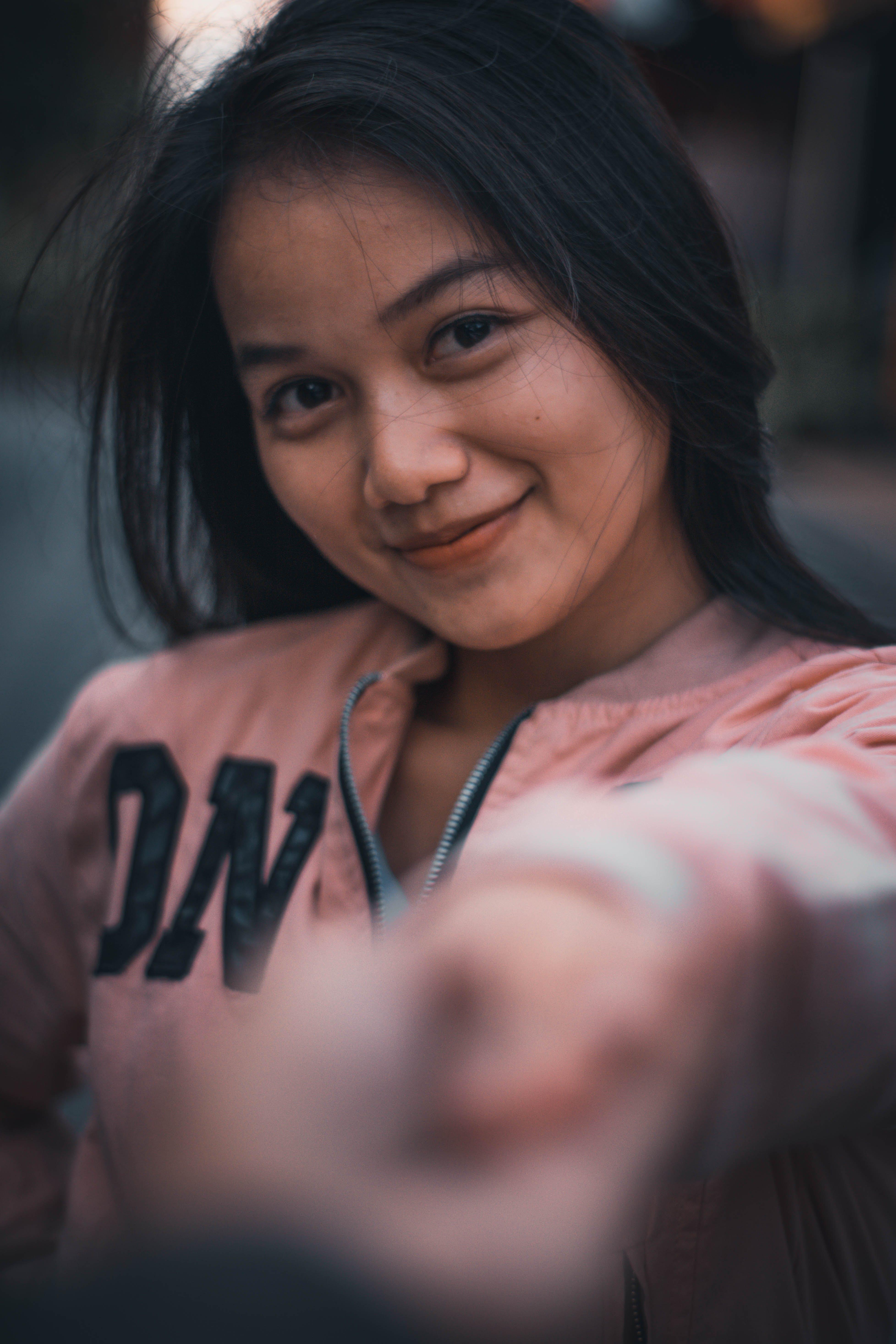 Woman in Pink Zip-up Jacket