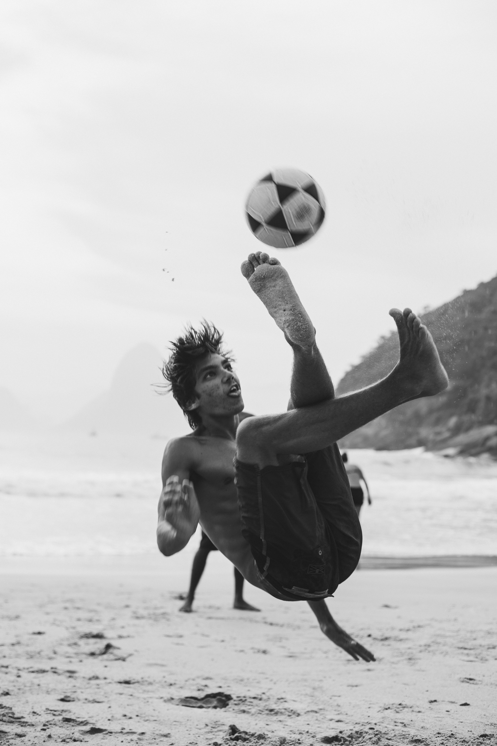 Grayscale Photography Of Man Playing Soccer