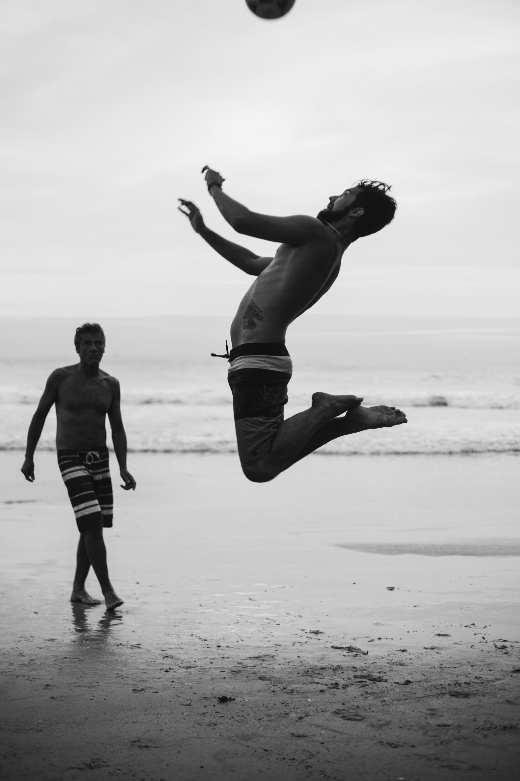 Two Men Playing Beach Volleyball