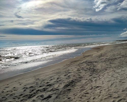 Foto stok gratis di tepi laut, pasir