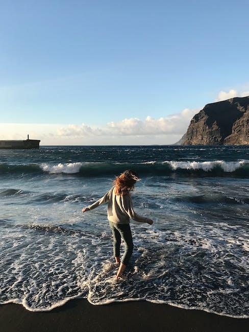 Photo of Woman Standing Near Seashore