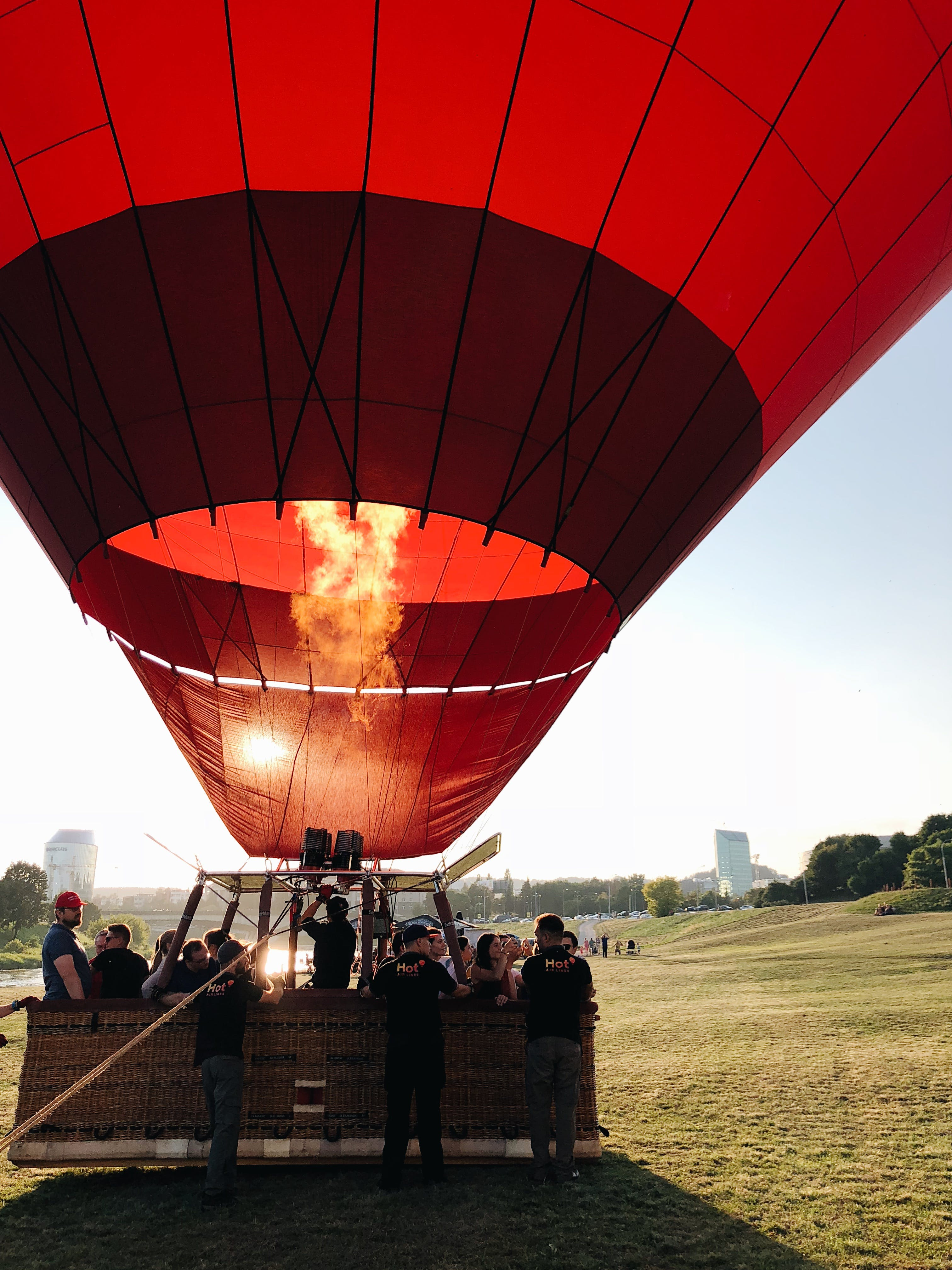 People Gathered Around Red Hot Air Balloon