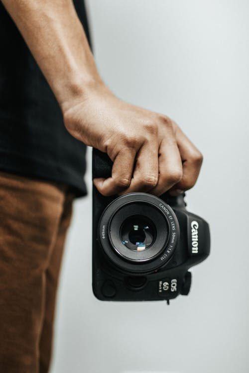 Person Holding Black Canon Eos 6d Dslr Camera