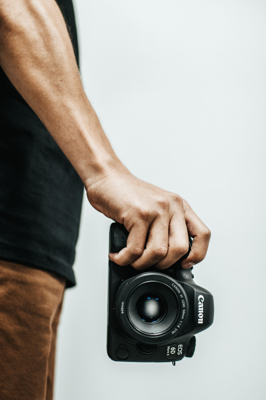Person Holding Canon Dslr Camea
