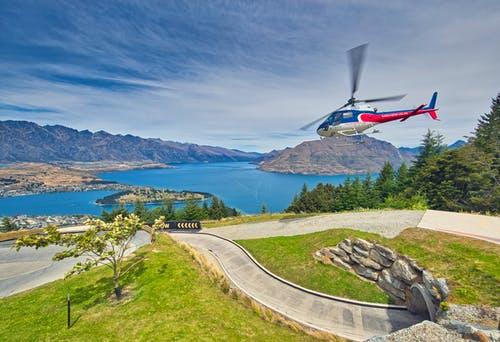 Ilmainen kuvapankkikuva tunnisteilla helikopterin laukaus, puut, queenstown, sininen vesi