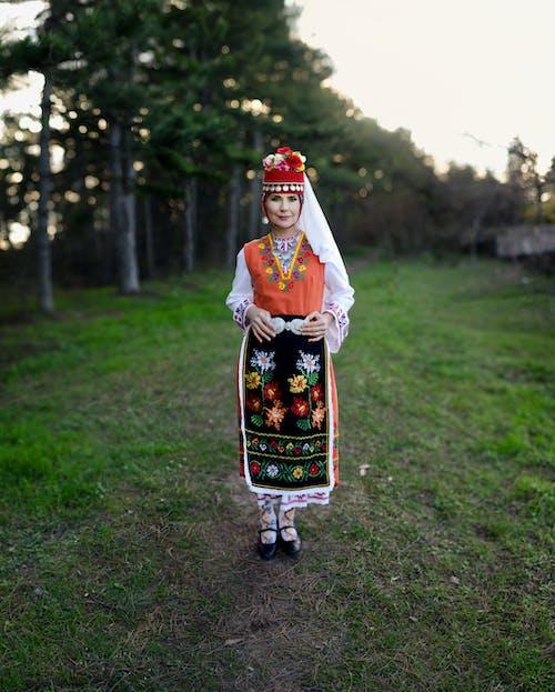 Selective Focus Photography of Woman Wearing Bulgarian Folk Costume