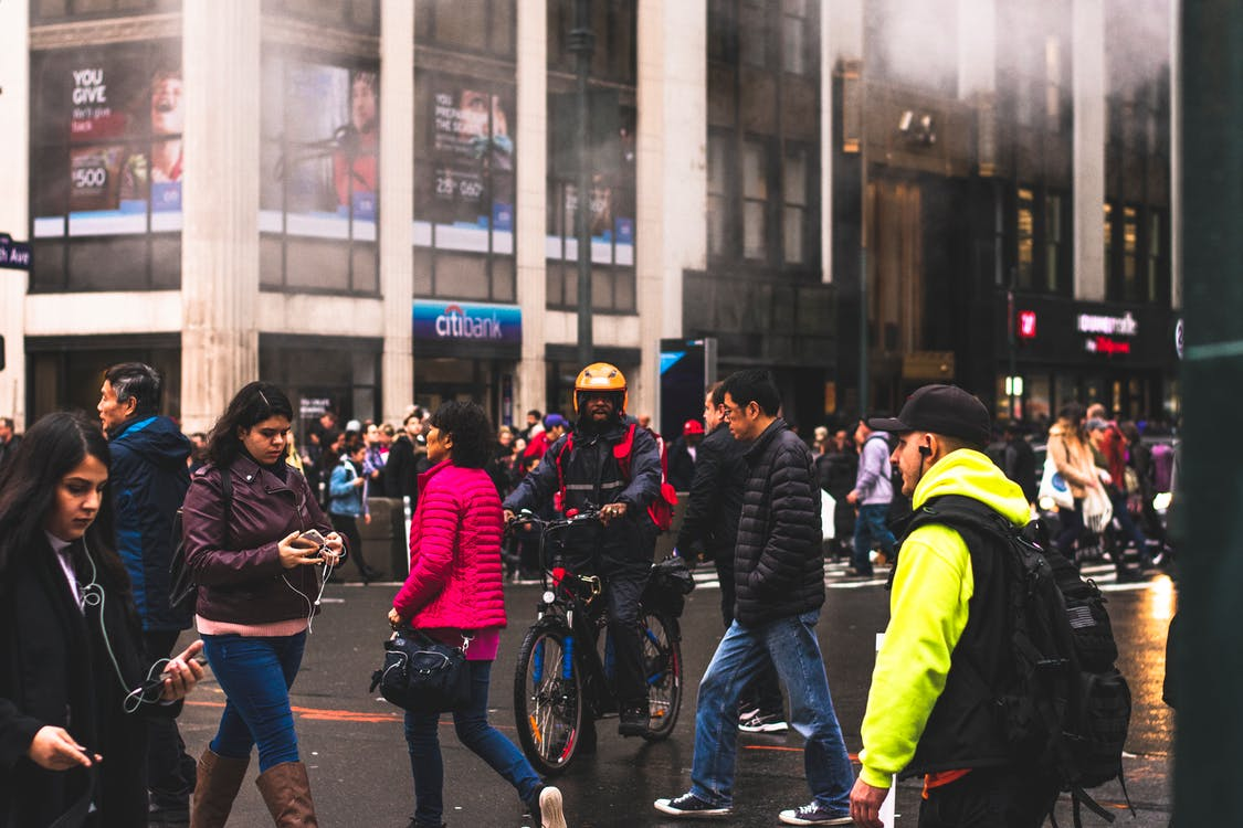 Group of People Walking on Road
