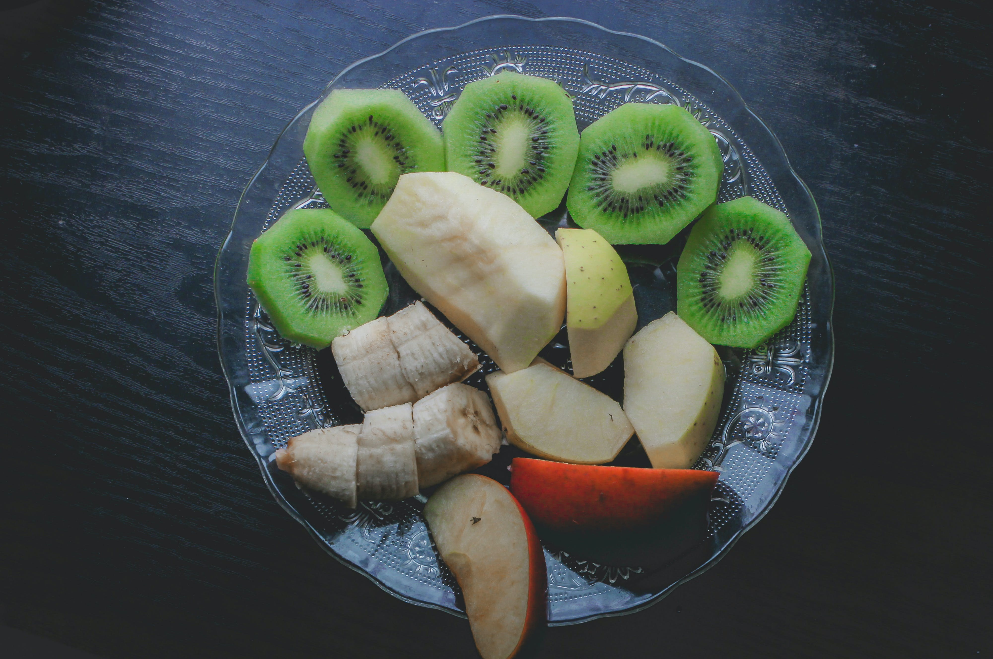 Sliced Fruits on Glass Plate
