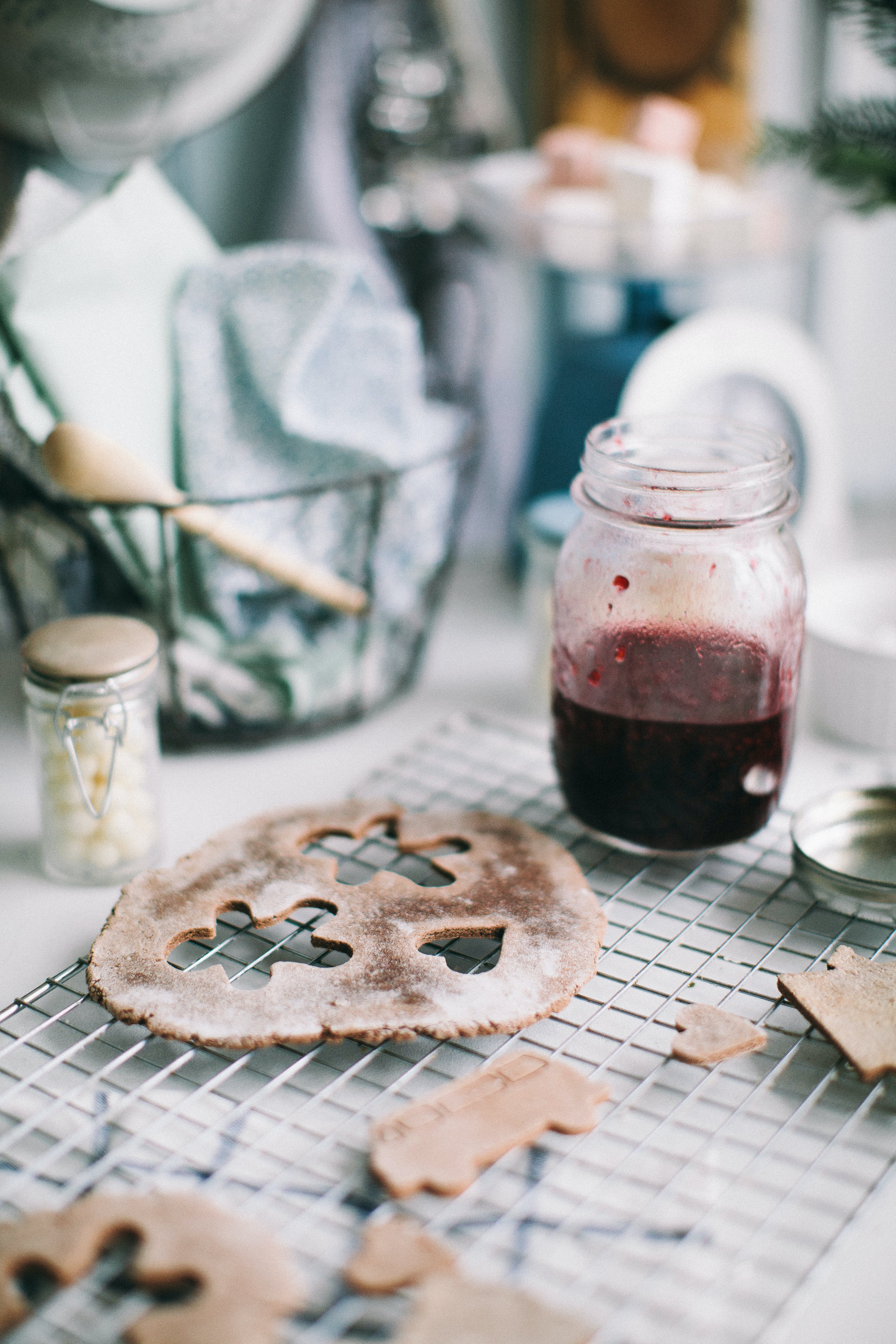 Glass Jar With Red Liquid Next to cookie cut outs
