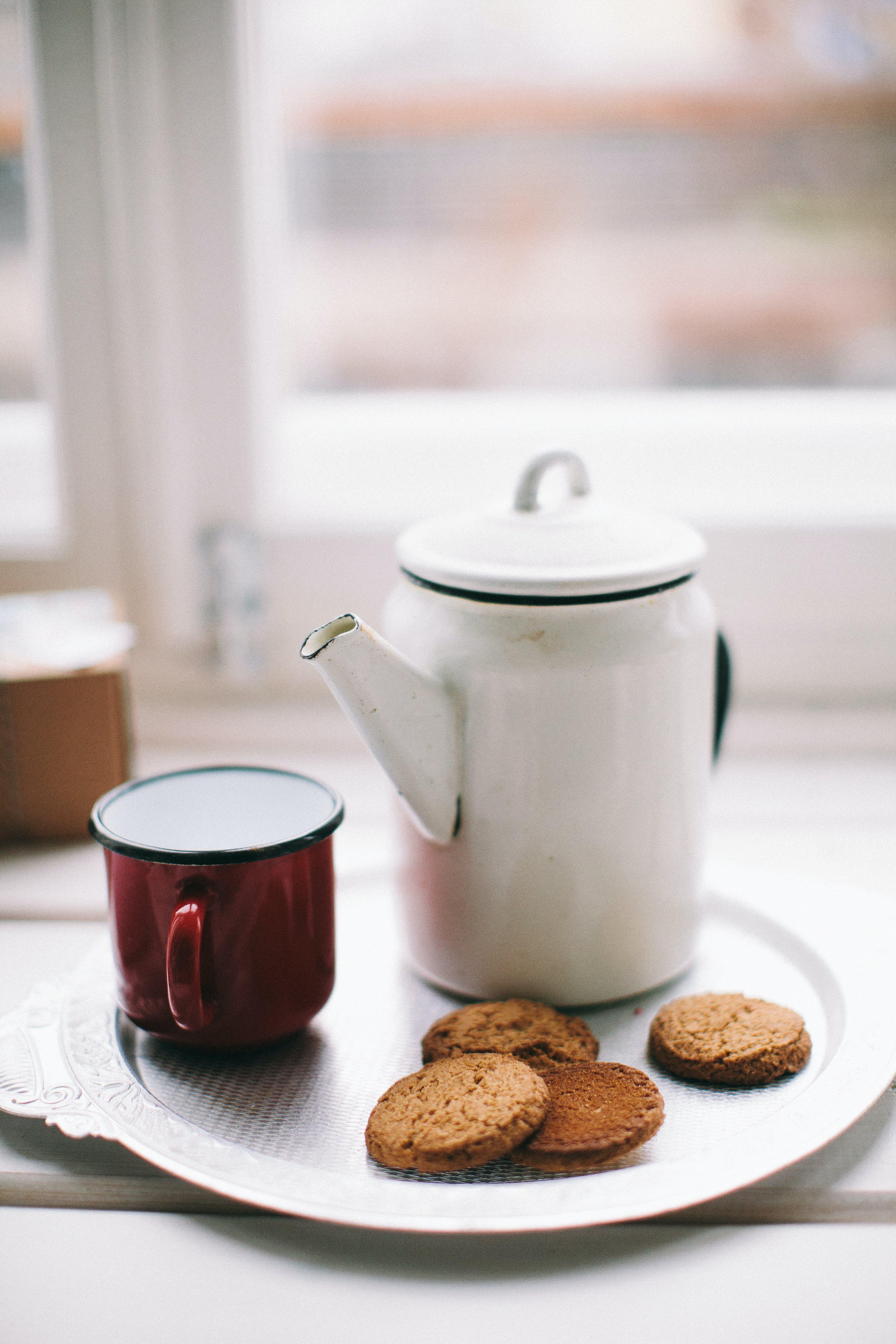 White Teapot, Red Mug And Cookies