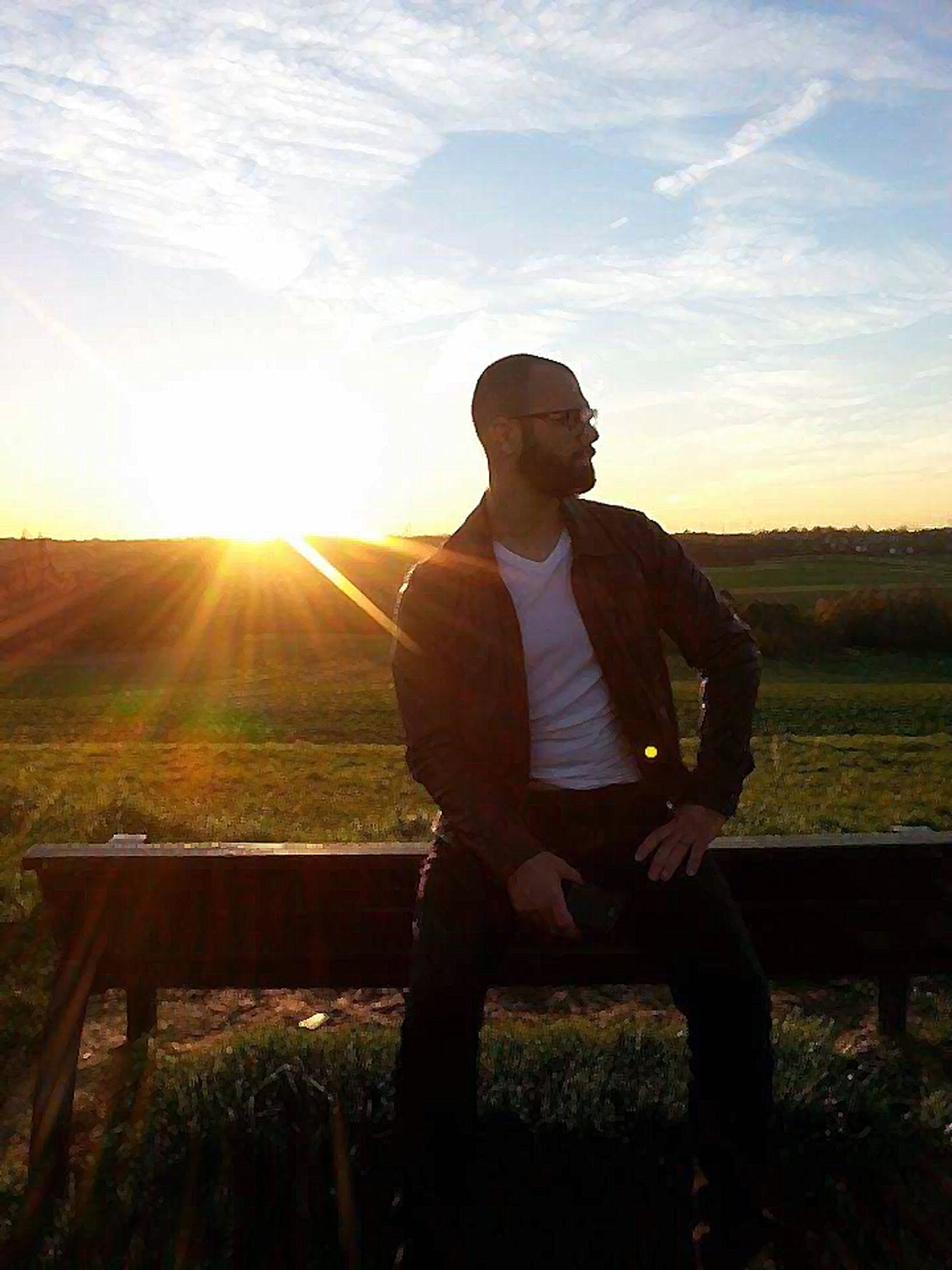 Man Sitting on Bench during Golden Hour Photography