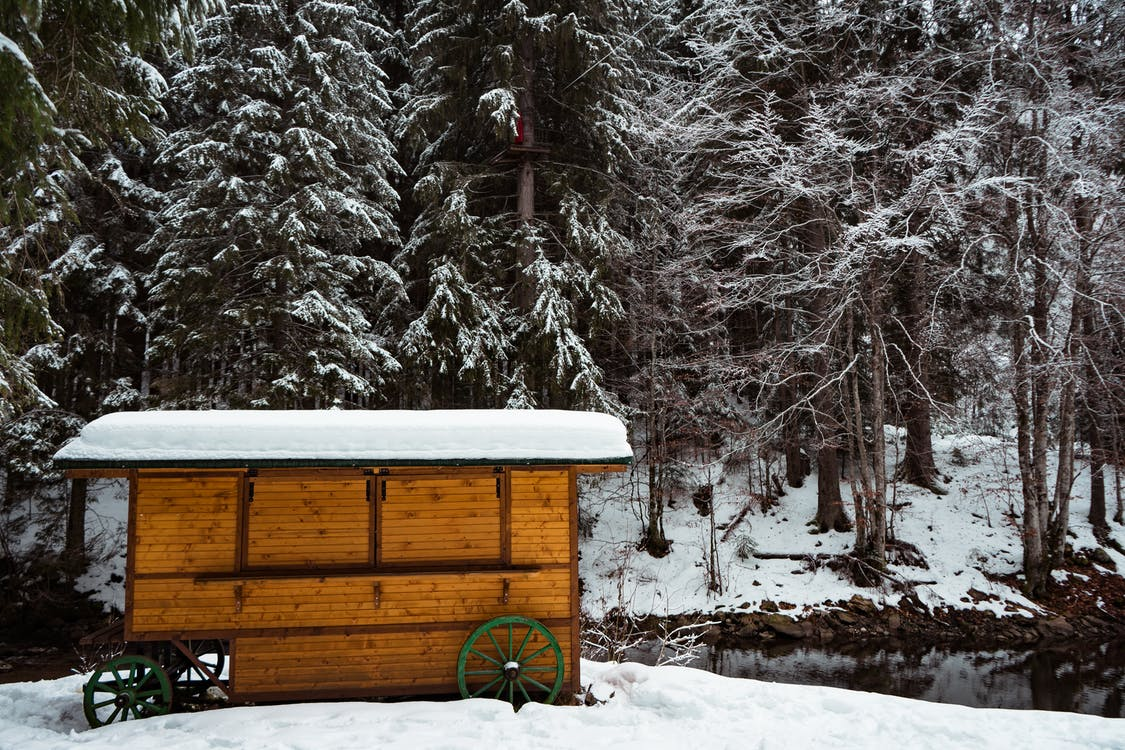 Photo of Wooden Shed Covered by Snow