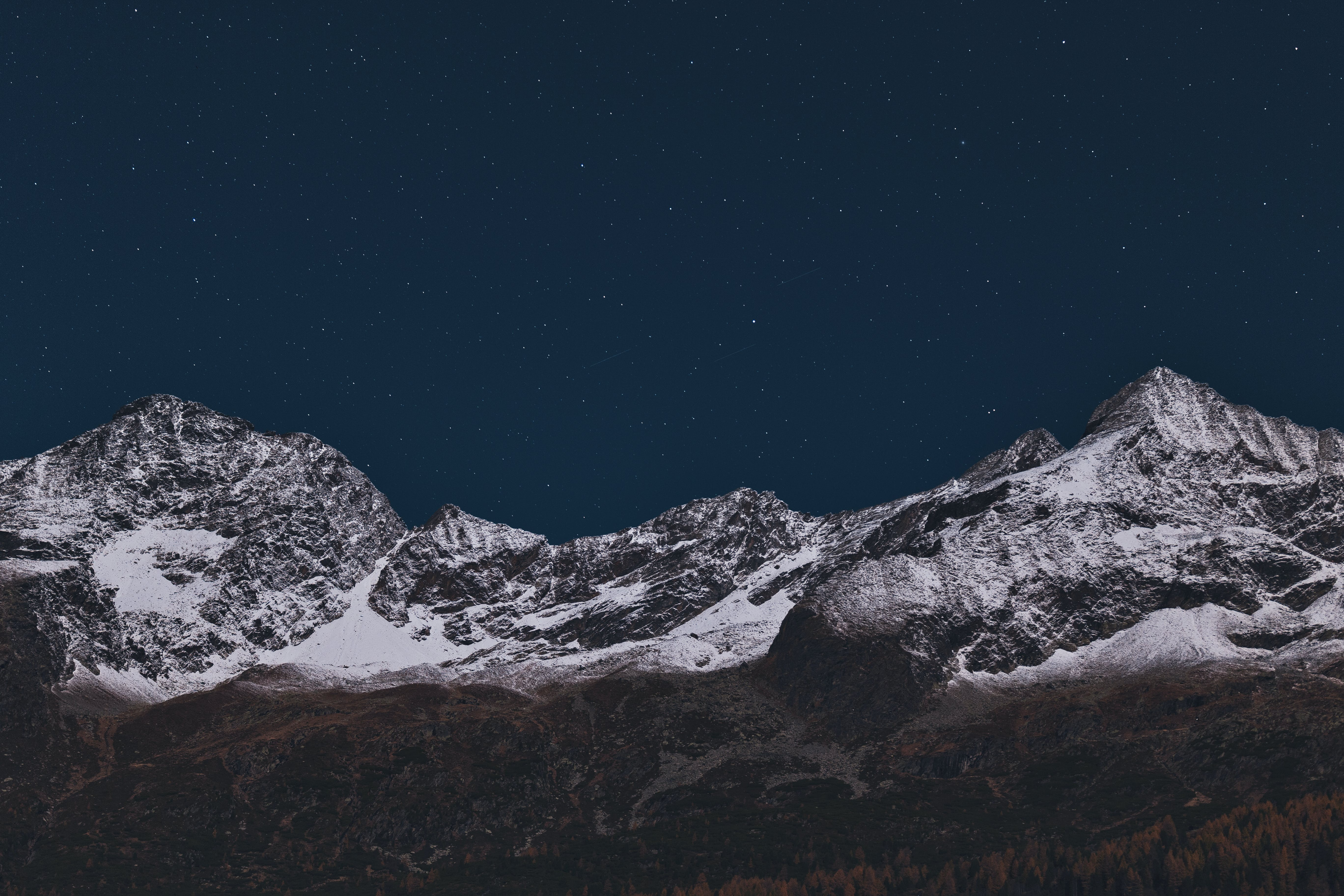 Mountain Covered With Snow During Nighttime