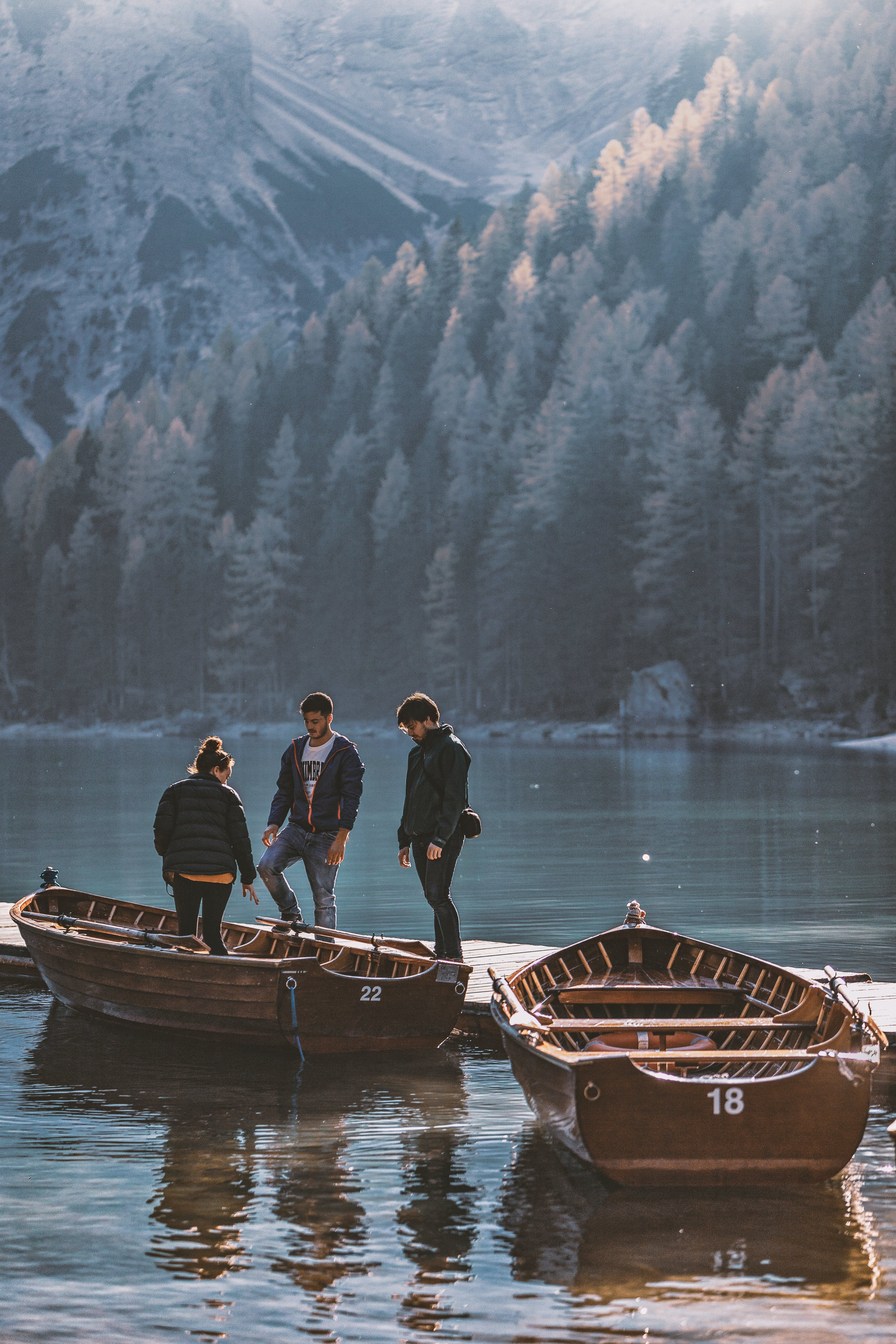 Men And A Woman Standing On Brown Boat