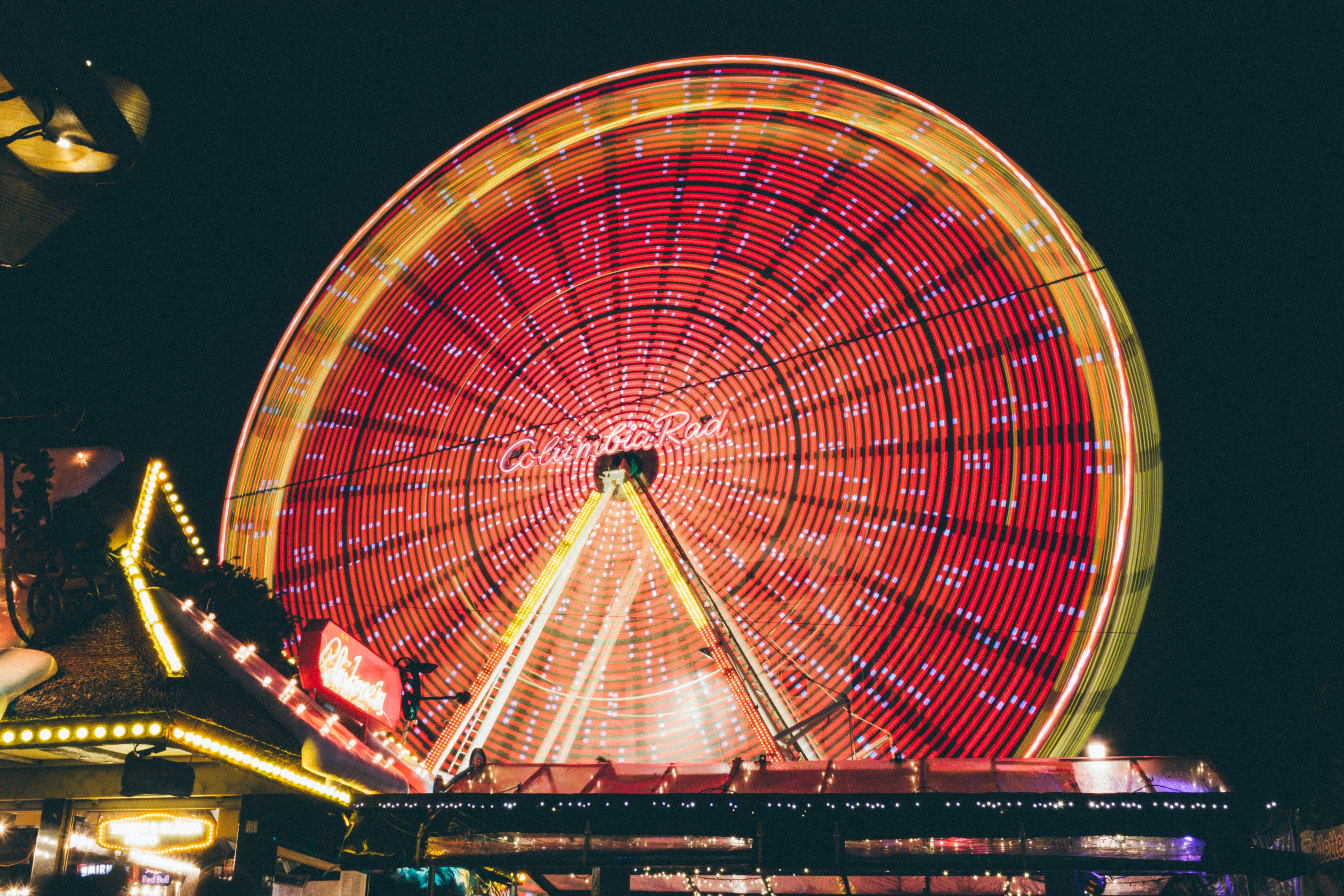 Time Lapse Photo of Red and Yellow Lighted Ferris Wheel