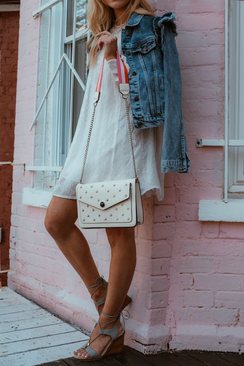 Woman Wearing White Dress Holding White Crossbody Bag
