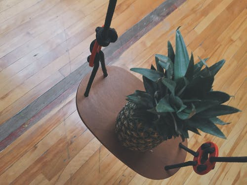 Pineapple on Brown Wooden Rack
