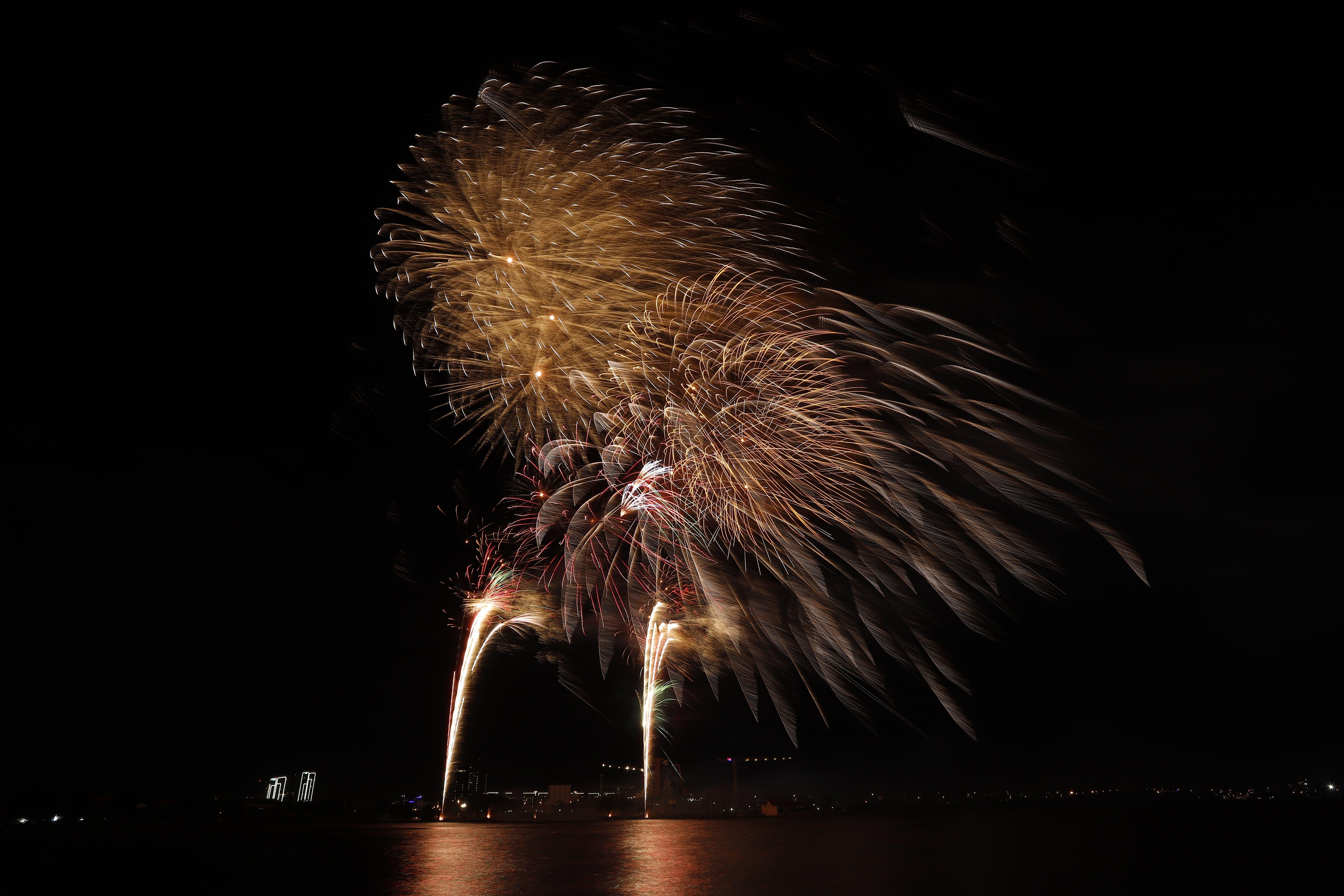 Free stock photo of firework, happy new year, light rain