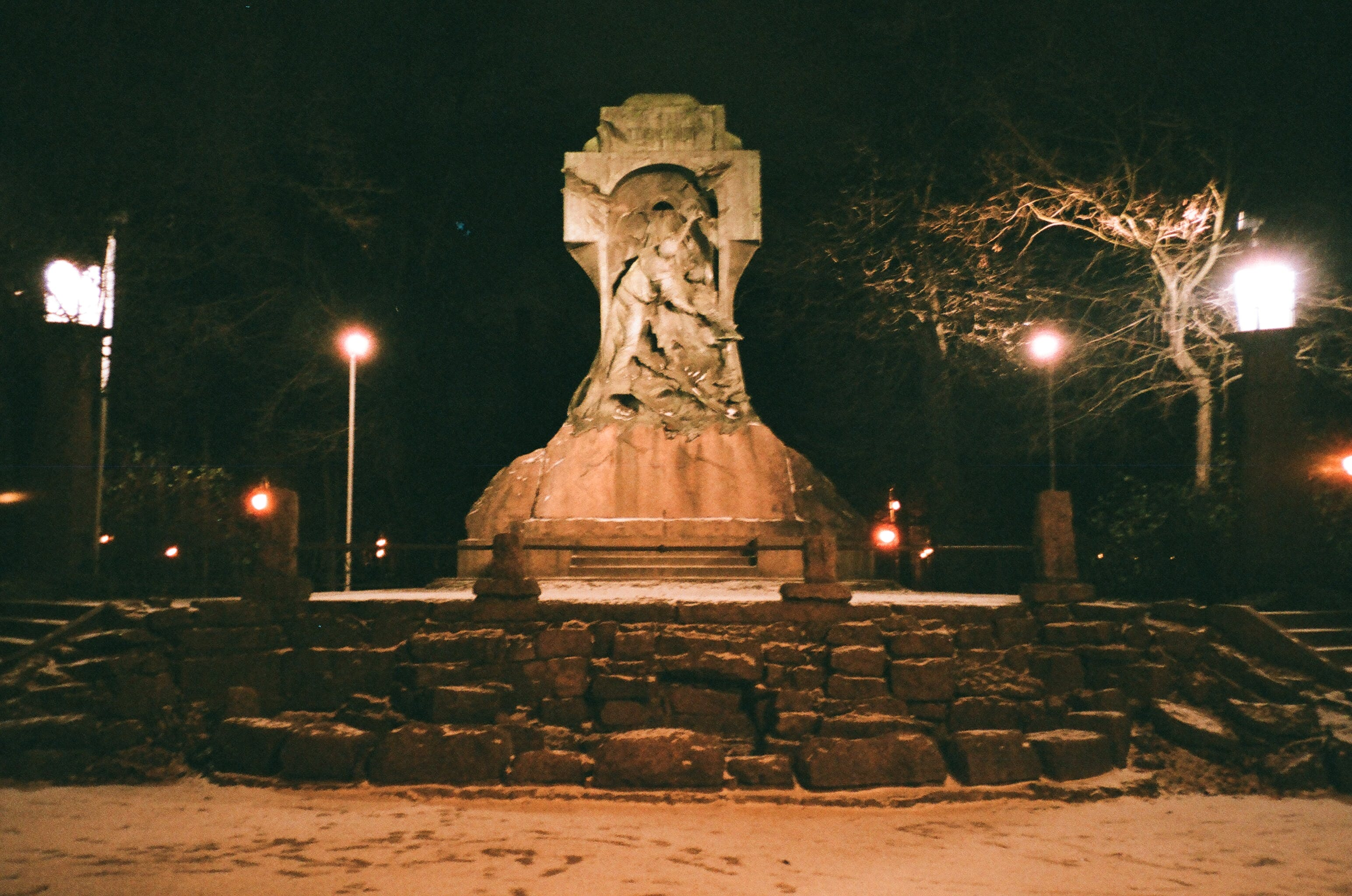 Lighted Concrete Statue during Night Time