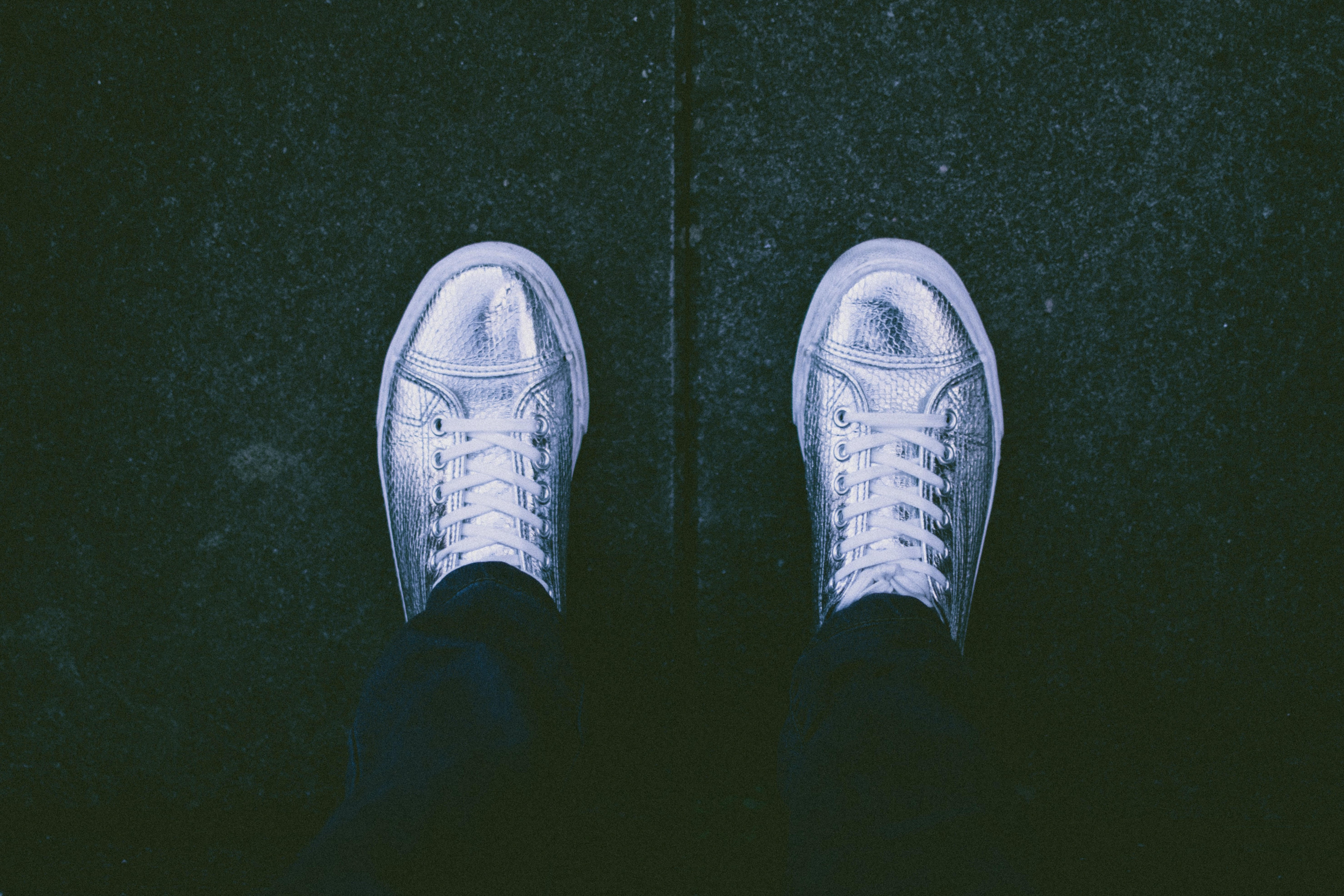 Top View Photo of Person Wearing Silver Shoes