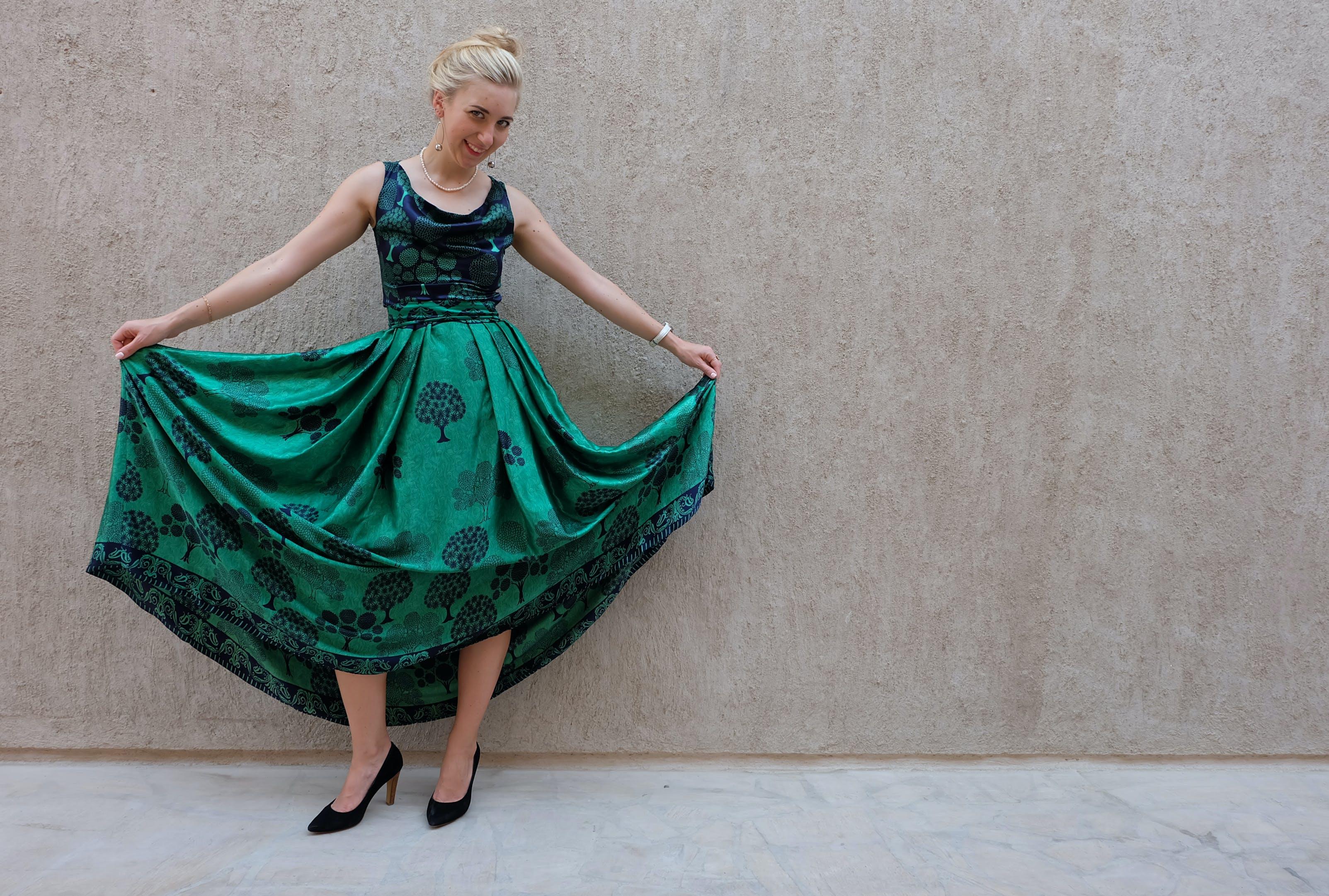 Woman Holding Her Green Dress